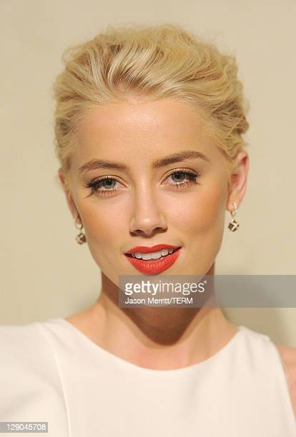 Actress Amber Heard arrives at the Giorgio Armani / Vanity Fair private dinner on October 11 2011 in Los Angeles California