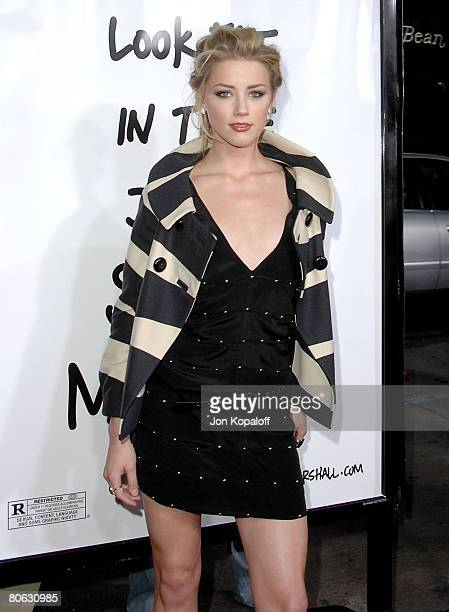 Actress Amber Heard arrives at the premiere Forgetting Sarah Marshall at the Grauman's Chinese Theater on April 10 2008 in Hollywood California