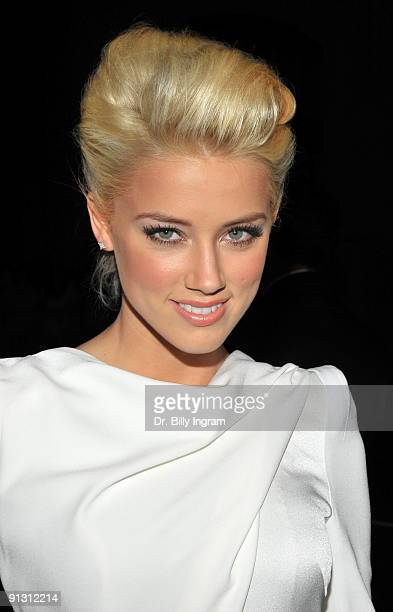 Actress Amber Heard arrives on the red carpet at the Los Angeles premiere of 'Zombieland' at the Grauman's Chinese Theatre on September 23 2009 in...