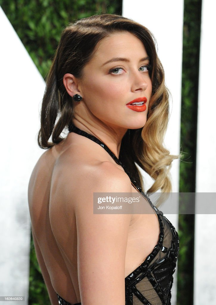 Actress Amber Heard attends the 2013 Vanity Fair Oscar party at Sunset Tower on February 24, 2013 in West Hollywood, California.