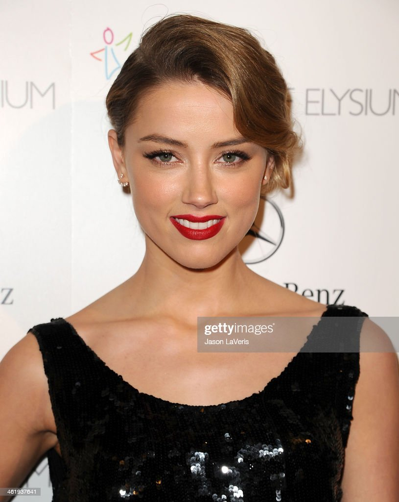 Actress Amber Heard attends the Art of Elysium's 7th annual Heavan gala at Skirball Cultural Center on January 11, 2014 in Los Angeles, California.