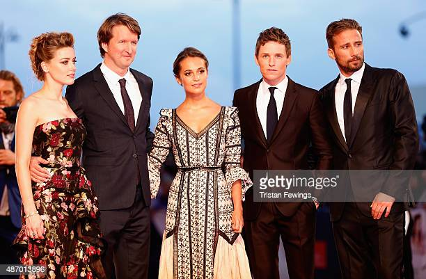 Actress Amber Heard director Tom Hooper actors Alicia Vikander Eddie Redmayne and Matthias Schoenaerts attend a premiere for 'The Danish Girl' during...