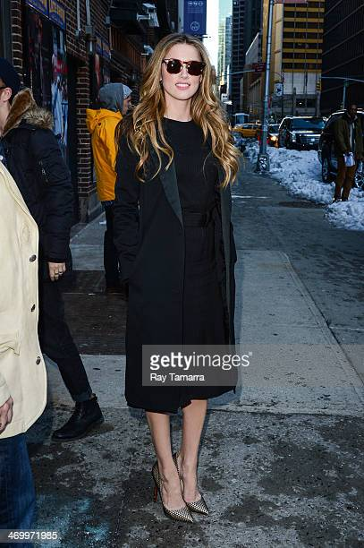 """Actress Amber Heard enters the """"Late Show With David Letterman"""" taping at the Ed Sullivan Theater on February 17, 2014 in New York City."""