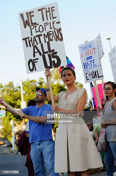 Actress Amber Heard holds a portest sign during a same-sex marriage advocates demonstration against the stay barring gay marriages on August 19, 2010...