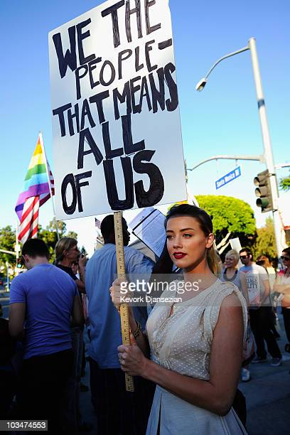 Actress Amber Heard holds a protest sign during a same-sex marriage advocates demonstration against the stay barring gay marriages on August 19, 2010...