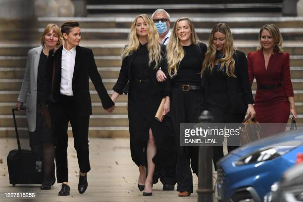 US actress Amber Heard leaves the High Court with partner Bianca Butti and sister Whitney after the final day of the libel trial by her former...