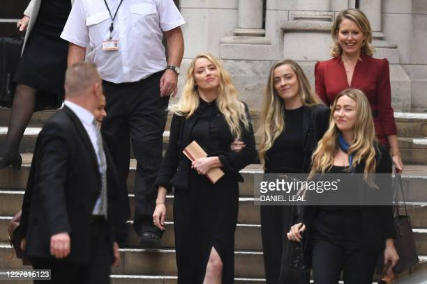 US actress Amber Heard leaves the High Court with sister Whitney after the final day of the libel trial by her former husband US actor Johnny Depp...