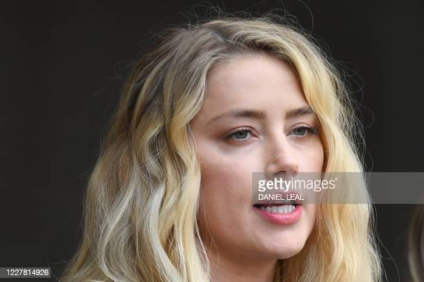 Actress Amber Heard makes a statement on the steps of the High Court after the final day of the libel trial by her former husband US actor Johnny...