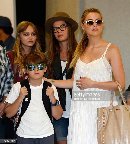 US actress Amber Heard partner US actor Johnny Depp his daughter LilyRose Melody and son Jack watch as the actor is greeted by fans upon arriving at...