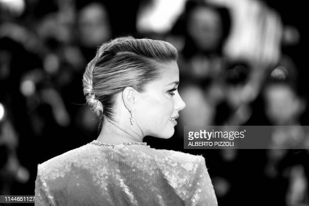"""Actress Amber Heard poses as she arrives for the screening of the film """"Les Miserables"""" at the 72nd edition of the Cannes Film Festival in Cannes,..."""