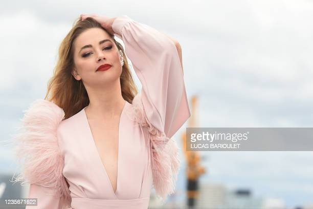 Actress Amber Heard presents a creation for L'Oreal on the sidelines of the Paris Fashion Week Spring-Summer 2022 Ready-to-Wear collection shows at...
