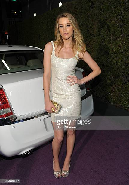 Actress Amber Heard with a Chrysler 300 at Vanity Fair Campaign Hollywood 2011 continues with the Cosmopolitan of Las Vegas The Art of Elysium Pieces...