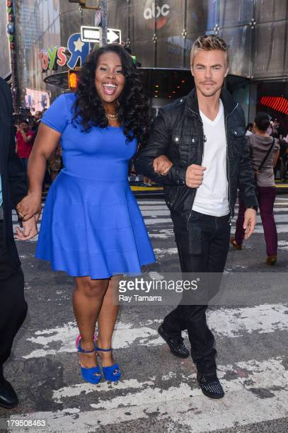 Actress Amber Riley and dancer Derek Hough leave the Good Morning America taping at the ABC Times Square Studios on September 4 2013 in New York City
