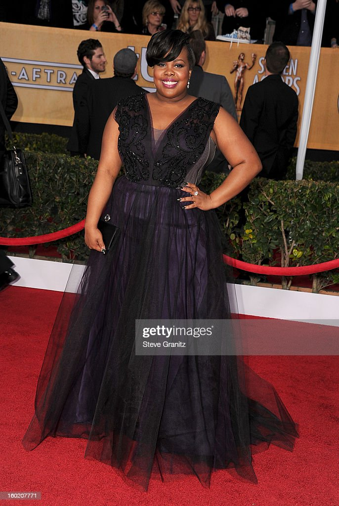 Actress Amber Riley arrives at the 19th Annual Screen Actors Guild Awards held at The Shrine Auditorium on January 27, 2013 in Los Angeles, California.