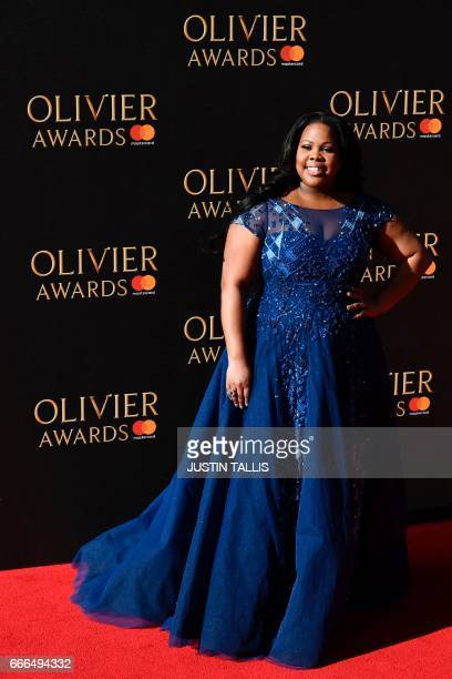 US actress Amber Riley poses on the red carpet upon arrival to attend the 2017 Laurence Olivier Awards in London on April 9 2017 / AFP PHOTO / Justin...