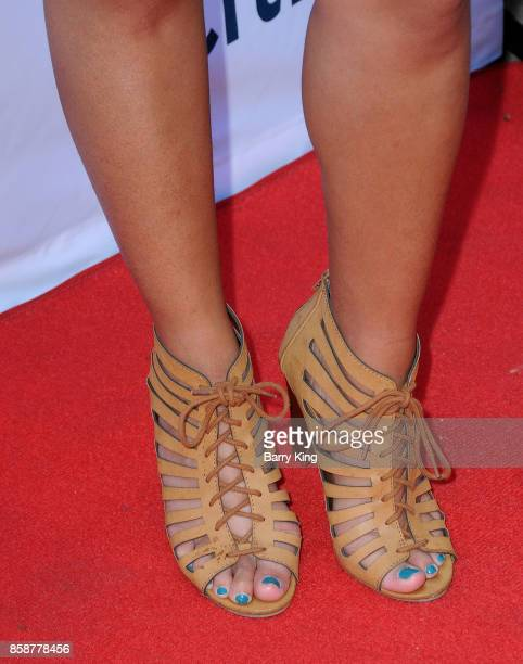 Actress Amber Romero shoe detail attends TJ Martell Foundation Family Day at The Grove on October 7 2017 in Los Angeles California