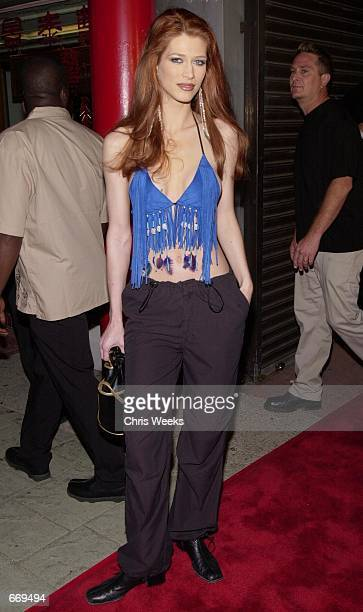 Actress Amber Smith attends Stuff Magazine's 7 Deadly Sins Escapade party July 20 2000 at the Old Chinatown section of Los Angeles CA