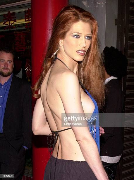 Actress Amber Smith attends Stuff Magazine's '7 Deadly Sins Escapade' party July 20 2000 at the Old Chinatown section of Los Angeles CA