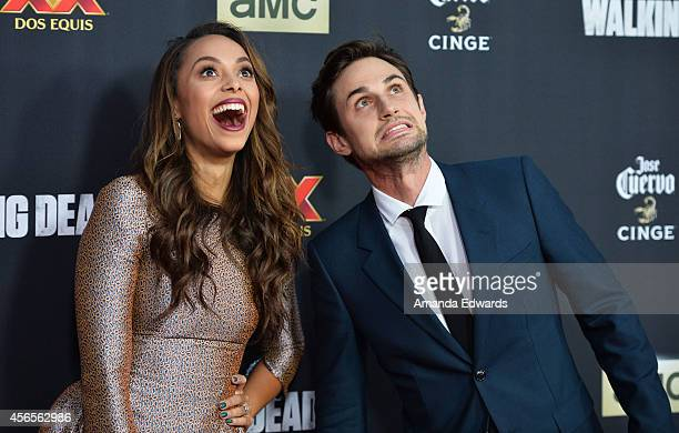 Actress Amber Stevens and actor Andrew J West arrive at the Season 5 premiere of AMC's 'The Walking Dead' at AMC Universal City Walk on October 2...