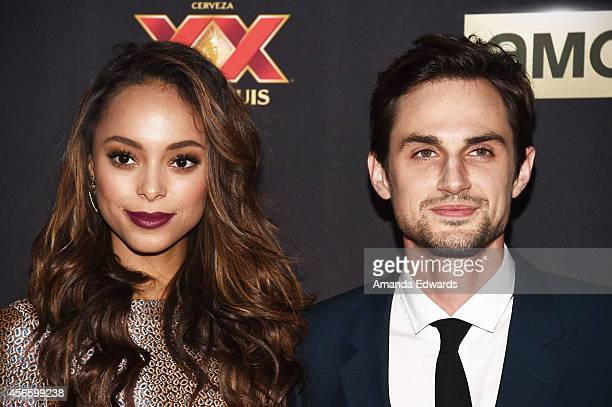Actress Amber Stevens and actor Andrew J West arrive at the Season 5 premiere of AMC's The Walking Dead at AMC Universal City Walk on October 2 2014...
