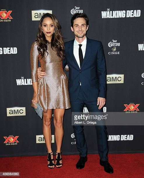 Actress Amber Stevens and actor Andrew J West arrive for the Season 5 Premiere Of 'The Walking Dead' held at AMC Universal City Walk on October 2...