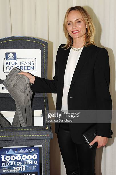 Actress Amber Valleta arrives at the Blue Jeans Go Green Event at SkyBar at the Mondrian Los Angeles on November 6 2013 in West Hollywood California