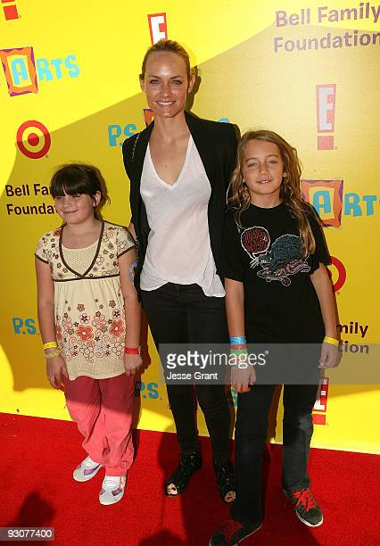 Actress Amber Valletta and her daughters attend the PS ARTS ''Express Yourself 2009'' at Barker Hangar on November 15 2009 in Santa Monica California