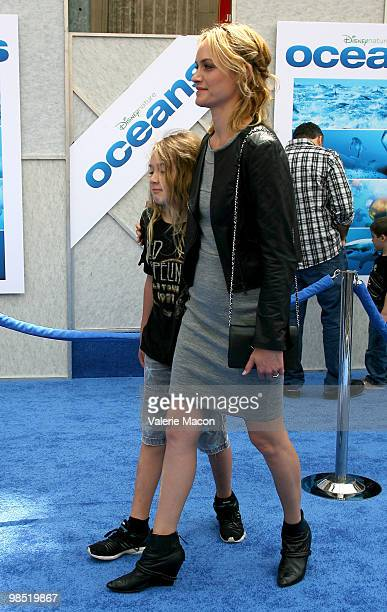 Actress Amber Valletta and son Auden McCaw arrives at the Premiere Of Disneynature's 'Oceans' on April 17 2010 in Hollywood California