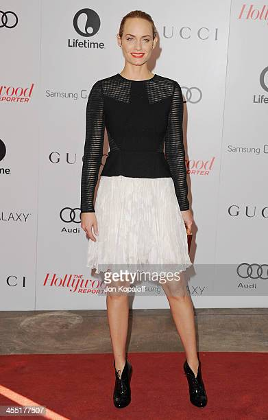 Actress Amber Valletta arrives at The Hollywood Reporter's 22nd Annual Women In Entertainment Breakfast 2013 at Beverly Hills Hotel on December 11...