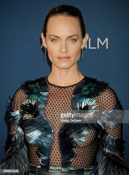 Actress Amber Valletta arrives at the LACMA 2013 Art Film Gala at LACMA on November 2 2013 in Los Angeles California