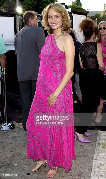 Actress Amber Valletta arrives at the premiere of her new film What Lies Beneath in Los Angeles 18 July 2000 The thriller also stars Harrison Ford...