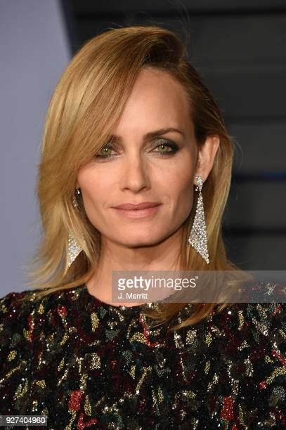 Actress Amber Valletta attends the 2018 Vanity Fair Oscar Party hosted by Radhika Jones at the Wallis Annenberg Center for the Performing Arts on...