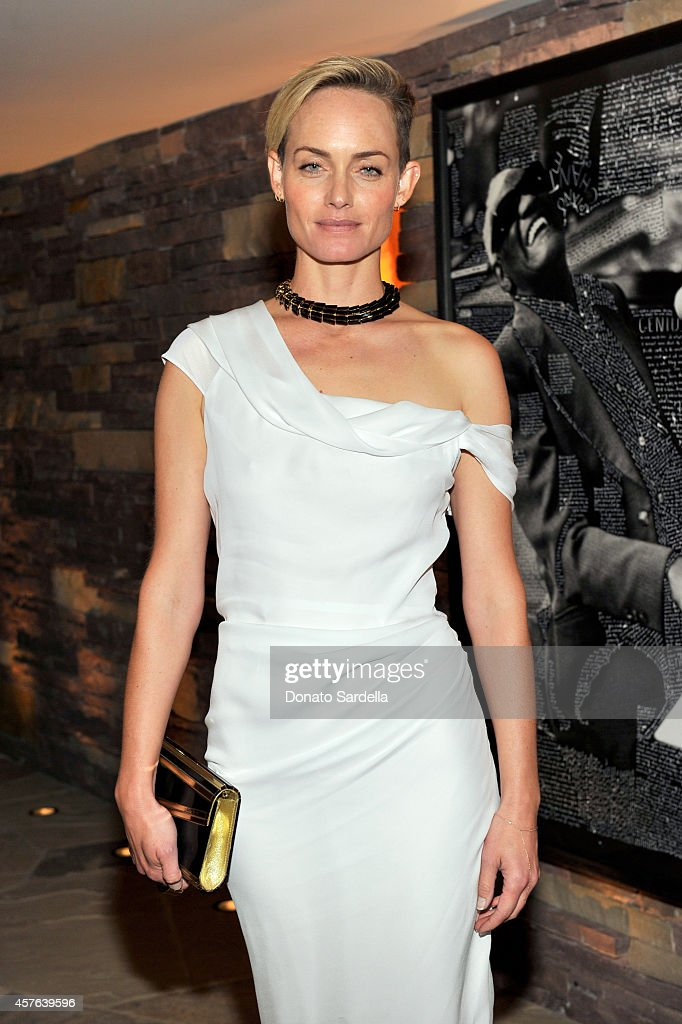 Actress Amber Valletta attends the CFDA/Vogue Fashion Fund evening dinner on October 21, 2014 in Los Angeles, California.