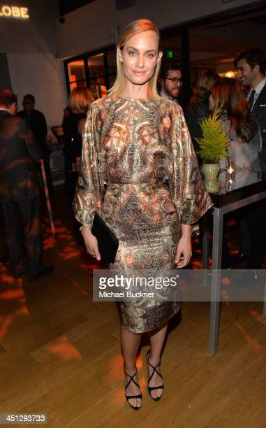 Actress Amber Valletta attends the HFPA and InStyle's Celebration of the 2014 Golden Globe Awards season and Miss Golden Globe at Fig Olive on...
