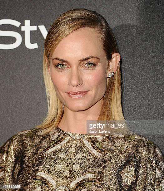 Actress Amber Valletta attends the Miss Golden Globe event at Fig Olive Melrose Place on November 21 2013 in West Hollywood California
