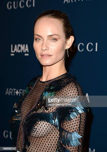 Actress Amber Valletta wearing Gucci attends the LACMA 2013 Art Film Gala honoring Martin Scorsese and David Hockney presented by Gucci at LACMA on...