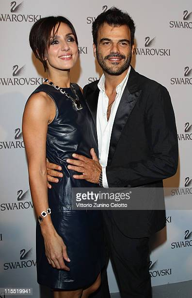 Actress Ambra Angiolini and singer Francesco Renga attend the Swarovski Fashionation at Palazzo Reale on June 7 2011 in Milan Italy