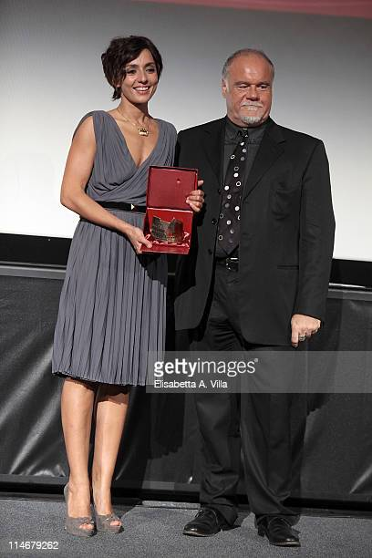Actress Ambra Angiolini receives the award for the best actress from Valter Casini during the 2011 Lazio Screen Awards at Adriano Cinema on May 25...