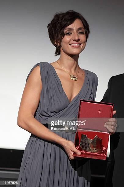 Actress Ambra Angiolini shows her award for the best actress during the 2011 Lazio Screen Awards at Adriano Cinema on May 25 2011 in Rome Italy