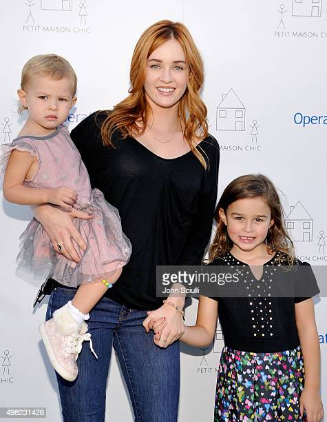 Actress Ambyr Childers and her children attend the Petit Maison Chic fashion show honoring Operation Smile on November 21 2015 in Beverly Hills...