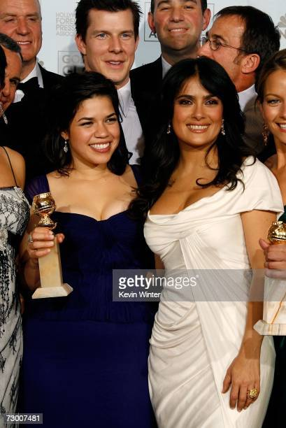 Actress America Ferrera actor Eric Mabius and actress Salma Hayek pose with their Best Television Series Musical or Comedy award for Ugly Betty...