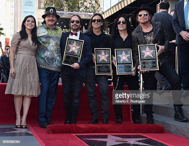 Actress America Ferrera recording artists Carlos Santana Sergio Vallin Juan Calleros Alex Gonzalez and Fher Olvera attend a ceremony honoring Maná...
