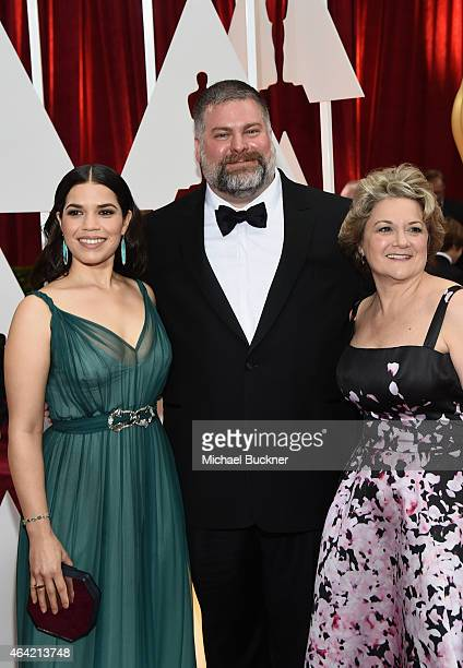 Actress America Ferrera writer/director Dean DeBlois and producer Bonnie Arnold attends the 87th Annual Academy Awards at Hollywood Highland Center...