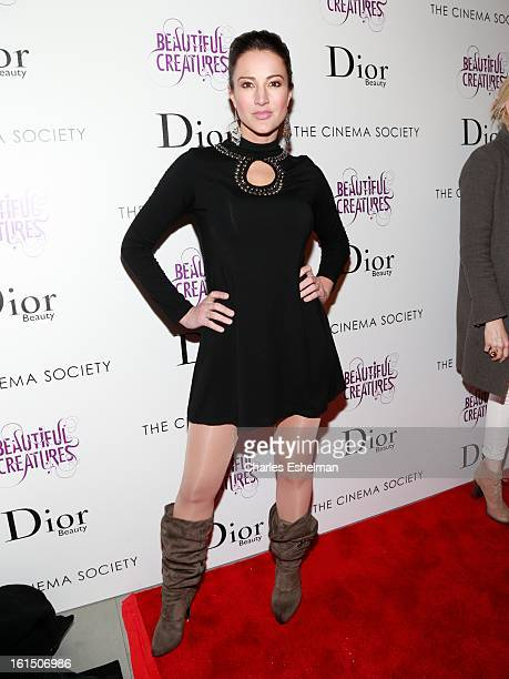 Actress America Olivo arrives at The Cinema Society And Dior Beauty host a screening of 'Beautiful Creatures' at Tribeca Cinemas on February 11 2013...