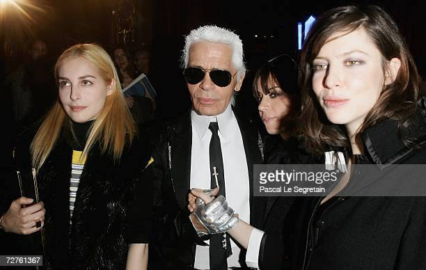 Actress Amira Casar designer Karl Lagerfeld singer Cat Power and actress Anna Mouglalis pose after the Chanel Paris Monte Carlo Fashion Show on...
