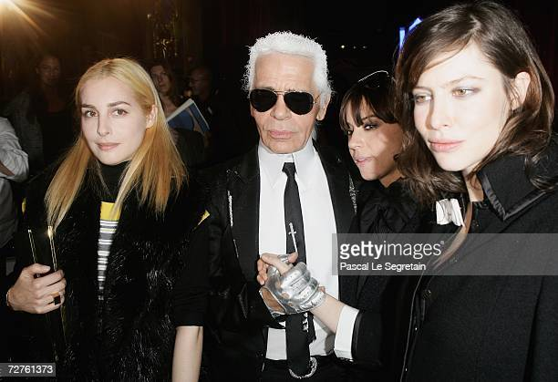 Actress Amira Casar designer Karl Lagerfeld singer Cat Power and actress Anna Mouglalis pose after a Chanel Fashion Show on December 7 2006 in Monte...