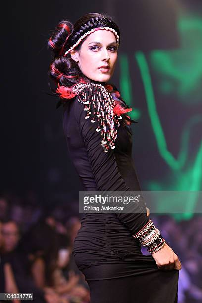 Actress Amrit Maghera walks the runway in an Malini Ramani design at the Lakme Fashion Week Winter Festive 2010 Day 5 at the Grand Hyatt on September...