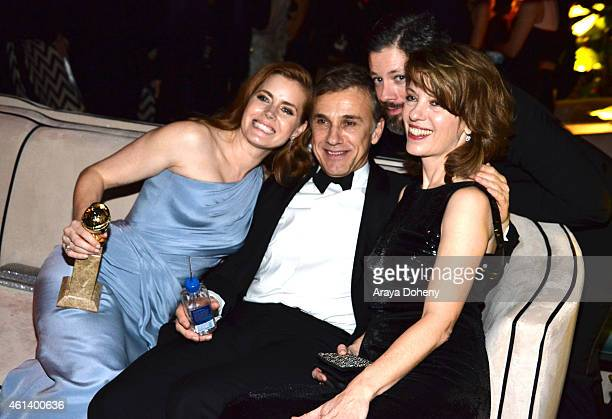 Actress Amy Adams actor Christophe Waltz Darren Le Gallo and Judith Holste attend The Weinstein Company Netflix's 2015 Golden Globes After Party...
