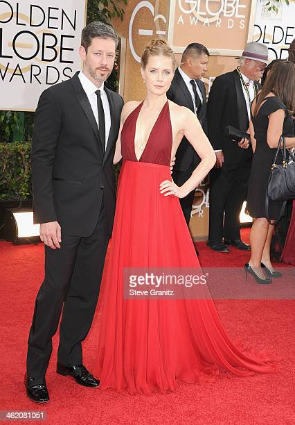 Actress Amy Adams and actor Darren Le Gallo attend the 71st Annual Golden Globe Awards held at The Beverly Hilton Hotel on January 12 2014 in Beverly...