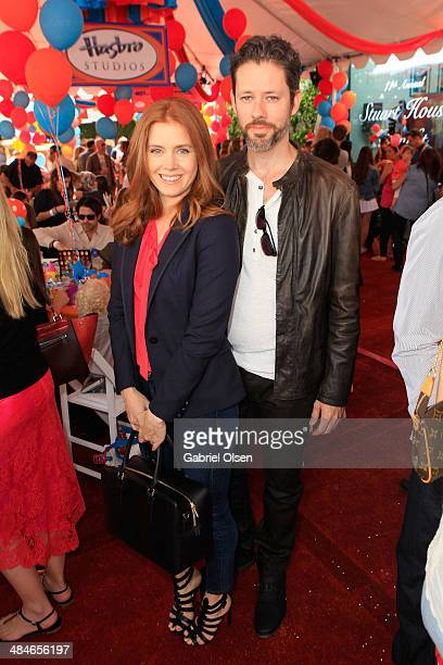 Actress Amy Adams and actor Darren Le Gallo attend the John Varvatos 11th Annual Stuart House Benefit presented by Chrysler Kids Tent by by Hasbro at...